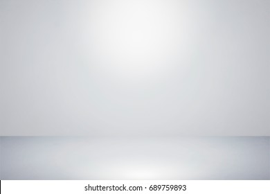 Grey,Empty gray white blank wall Room interior,Blurry Soft Light Background,Flat Floor and Dark Wall to Show for Montage or Display Products,Blur Abstract Circular grey Light Well Use as Background.