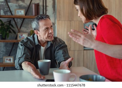 Grey-haired man. Mature grey-haired man feeling completely furious while having family conflict with his wife