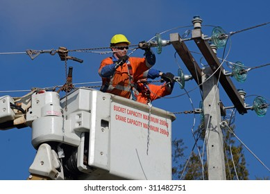 GREYMOUTH, NEW ZEALAND, AUGUST 5, 2015: A linesman wires up a mains power supply cable on a new pole near Greymouth, August 5, 2015
