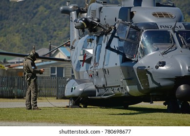 GREYMOUTH, NEW ZEALAND, NOVEMBER 18, 2017: An unidentified crew member makes a pre-flight check on an Air Force NH90 helicopter at an open day run by the New Zealand armed forces.
