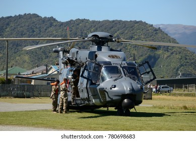 GREYMOUTH, NEW ZEALAND, NOVEMBER 18, 2017: The support crew prepares to board an Air Force NH90 helicopter at an open day run by the New Zealand armed forces.