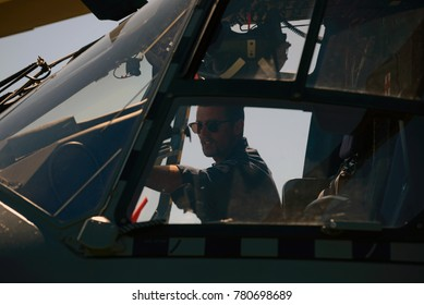 GREYMOUTH, NEW ZEALAND, NOVEMBER 18, 2017: An unidentified pilot makes a pre-flight check on an Air Force NH90 helicopter at an open day run by the New Zealand armed forces.