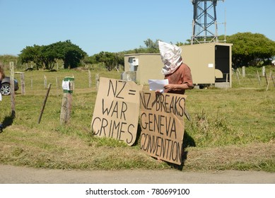GREYMOUTH, NEW ZEALAND, NOVEMBER 18, 2017: A protester demonstrates against New Zealand breaking the Geneva Convention at an open day for the defence forces at Greymouth, New Zealand.