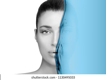 Greyscale beauty portrait of a gorgeous brunette woman. Perfect skin with no makeup makeup and half her face obscured by a blue water in a hydration and skin care concept