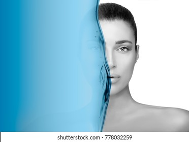 Greyscale beauty portrait of a gorgeous brunette woman. Perfect skin with no makeup makeup and half her face obscured by a blue wave in a moisturizing and skin care concept