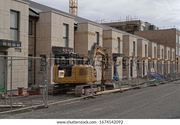 GREYSTONES, CO. WICKLOW, IRELAND - MARCH 16, 2020: A street view of the building site with newly built detached houses. It's the part of the Glenveagh Marina Village development in Greystones.