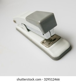 Grey-white  Stapler on white background.