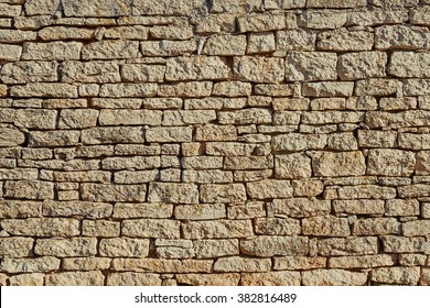 Grey-yellow stones. A wall. Abstract. Structures. A background. Spring