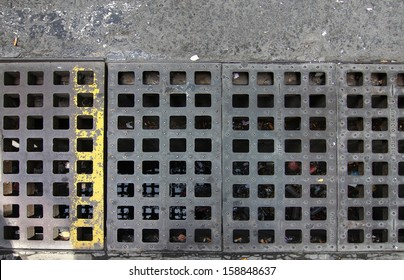 grid in the floor of a drain