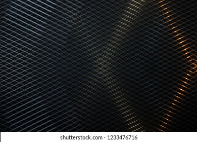 Grid structure. Reworked close-up of modern architecture fragment with louvers / blinds / shutters in darkness. Geometric composition with checkered pattern.