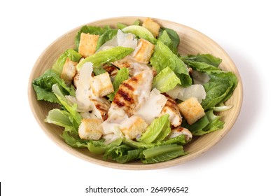 Griddled chicken caesar salad on white background