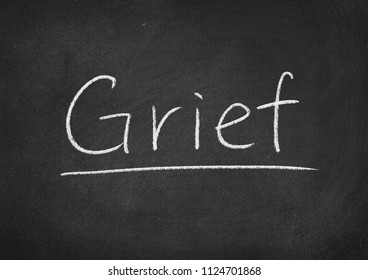 grief concept word on a blackboard background