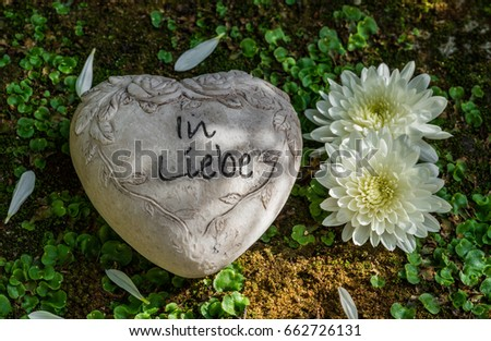 Grief heart white flowers on grave stock photo edit now 662726131 grief heart with white flowers on grave german text in liebe means in love mightylinksfo