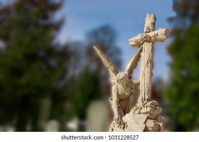 Grieving angel puts a bouquet of flowers (religion, unique architecture)