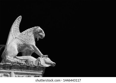 Griffon symbol of the city of Perugia in Umbria. Ancient 14th century medieval marble statue of the mythical beast (Black and White with copy space)
