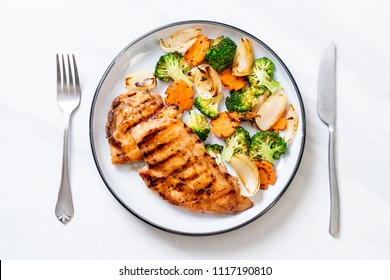 griled chicken breast steak with vegetable (broccoli,carrot,onions)
