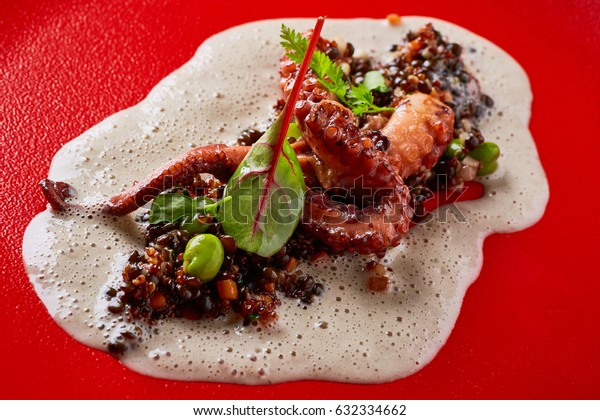 Griled octopus with lentils salad and foam
