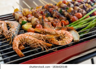 Grill and Barbecue party at home. Cooking BBQ pork, beef, chicken, seafood and vegetables. Family lifestyle and friend outdoor activity.