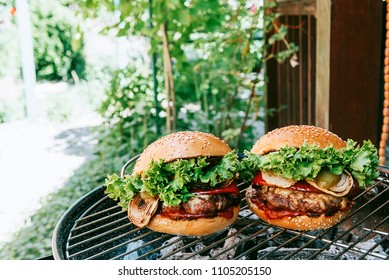 grill with burgers