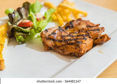 grill chicken steak on white plate