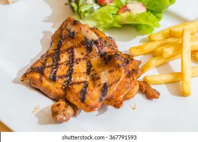 grill chicken steak on white plate
