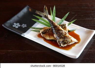 Grill fish with sauce , Saba fish teriyaki sauce  japanese food with dark brown wood pattern