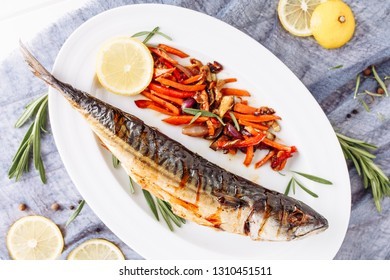 Grill Fried Mackerel Scomber Fish Top Flat Lay. Whole Golden Smoked Cooked Maccarello with Vegetable, Rosemary and Lemon Above View on White Plate. Barbecue Prepared Cuisine Seafood Recipe