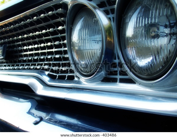 Grill and headlights on vintage automobile.