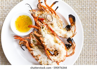 grill lobsters on white plate