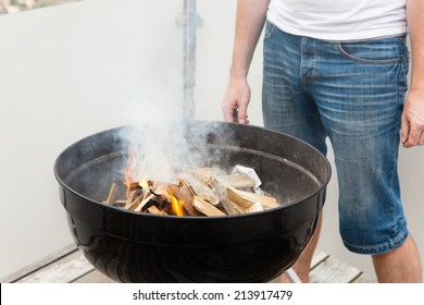 Grill master when igniting the fire of the grill
