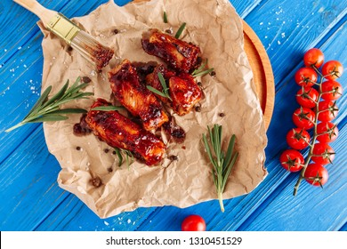 Grill Pork Ribs Meat in Barbecue Sauce Top Down View. Bbq Beef Board with Rosemary and Cherry Tomato Flat Lay on Wooden Blue Background. Traditional American Steakhouse Roast Food. Unhealthy Dinner