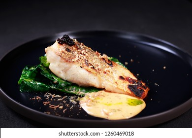 grill pub and fish restaurant menu, delicious pikeperch with spinach garnishing and sauce, grilled zander. main dish, banquet, food photo