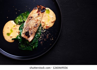 grill pub and fish restaurant menu, food photo art. delicious pikeperch with spinach garnishing and sauce, grilled zander