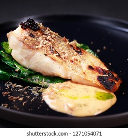 grill pub and fish restaurant menu, delicious pikeperch with spinach garnishing and sauce, grilled zander. diet food, proper nutrition, seafood, vegetarian, pescetarian