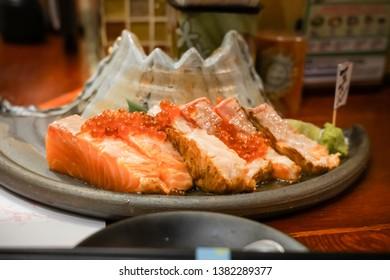 grill salmon sashimi in the mountain design dish (Japanese food)
