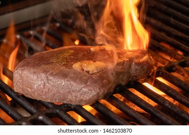 grill steak on fire close up