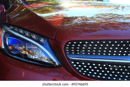 Grille and headlight on red car