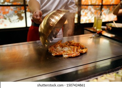 Grilled Alaskan king crab legs (Snow crab) on teppanyaki grill plate, Prepared for Teppanyaki style, Enjoy the spectacle of a giant crab cooked to perfection by chef. Traditional Japenese steakhouse.