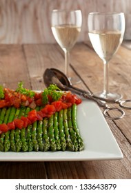 Grilled asparagus, served with a tomato vinaigrette