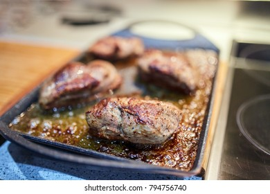 Grilled and baked duck breast in an oven tray