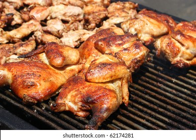 Grilled barbecue chicken on open grill