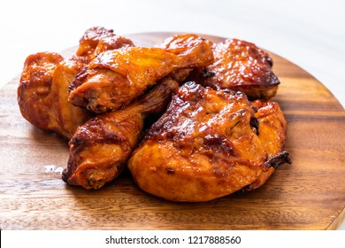 grilled and barbecue chicken on table