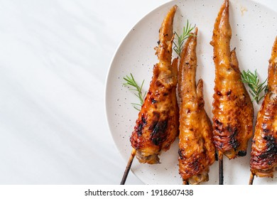 grilled or barbecue chicken wings skewer on plate