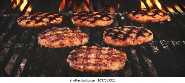 Grilled BBQ Burgers Patties On The Hot Flaming Charcoal Grill. Top View. Cookout Food, Good Snack For Outdoor Family Party Or Picnic