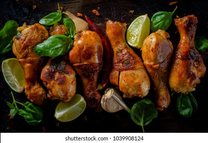 Grilled bbq spicy chicken legs on a metallic background. Top view.