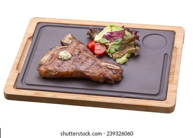 Grilled BBQ t-bone steak with fresh vegetables on stone board isolated on white background