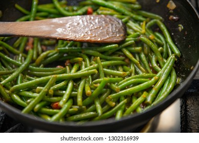Grilled beans with hot sauce and bacon