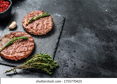 Grilled Beef burger patties. Meat cutlet. Black background. Top view. Copy space