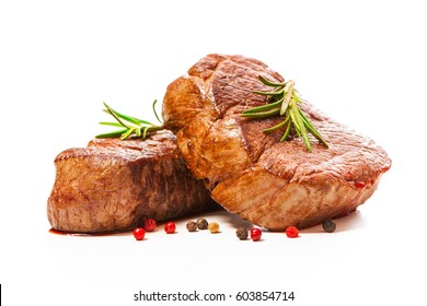 Grilled beef fillet steaks with herbs and spices isolated on white background