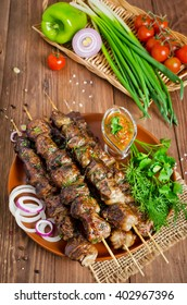 Grilled beef liver kebabs wrapped the fatty in a grid
